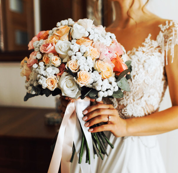 brideo holding a bouquet of flowers
